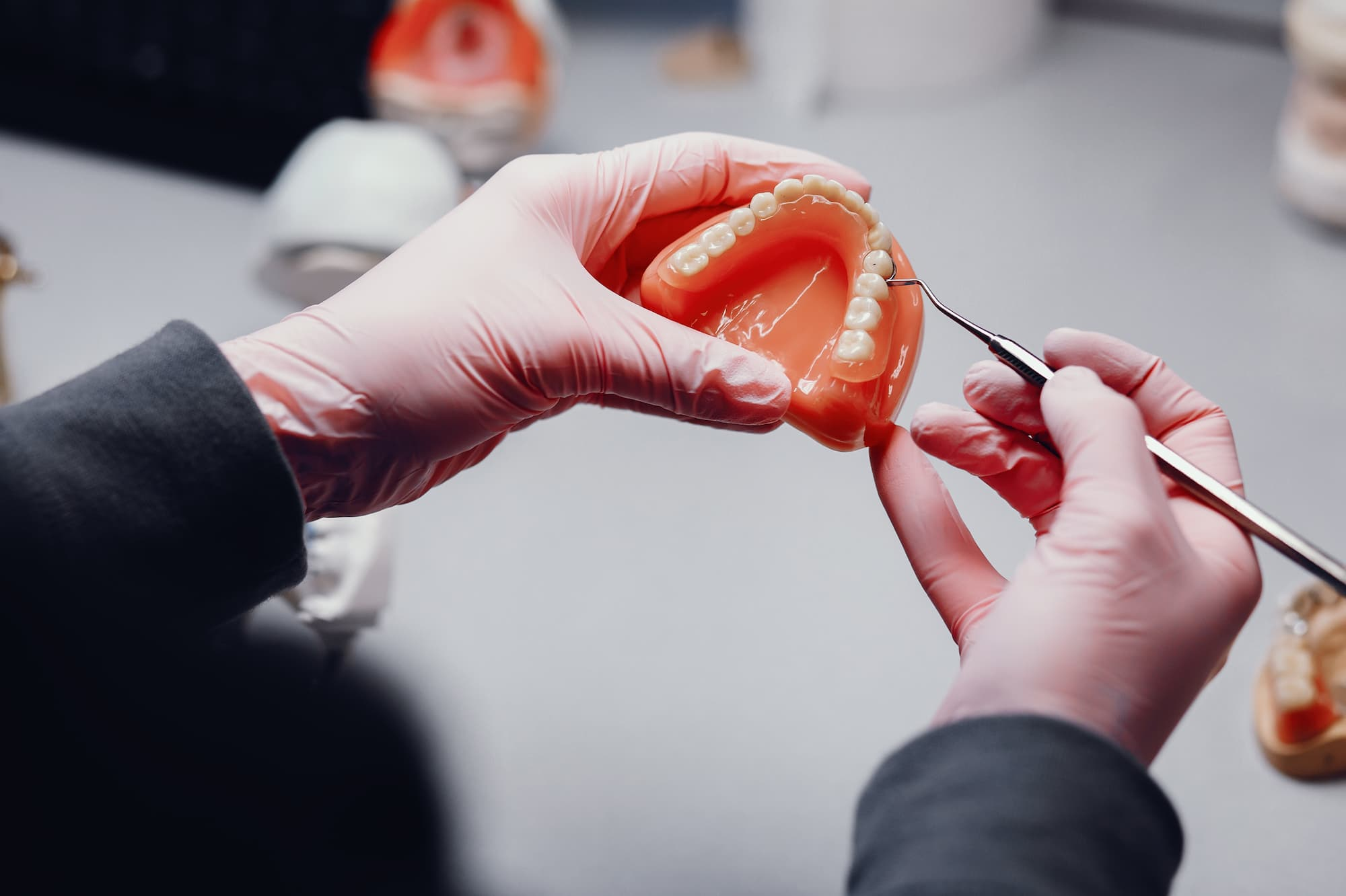 Acrylic denture being repaired by technician